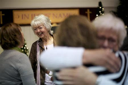 Members of the congregation at New Covenant Community Church greet Terri Roberts, the mother of Amish school shooter Charles Roberts, in Delta, Pennsylvania December 1, 2013. REUTERS/Mark Makela
