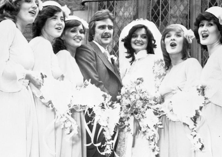 The Nolan Sisters sing 'It's Only Just Begun' for their sister Anne and her bridegroom Blackpool footballer Brian Wilson, following their wedding at the Church of the Sacred Heart in Blackpool. The singing bridesmaids are (l-r) Linda, 20, Coleen, 14, Maureen, 25, Bernadette 'Bernie', 18 and Denise, 27.   (Photo by PA Images via Getty Images)