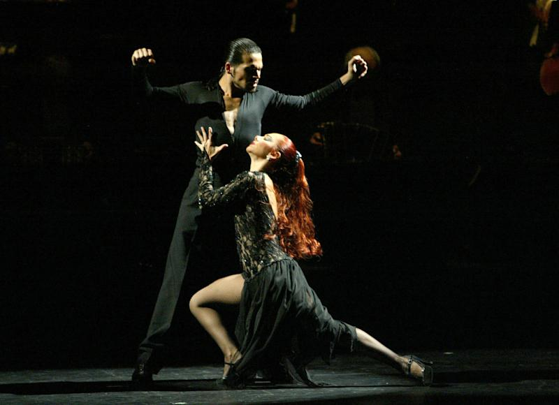 "FILE - This 2004 file photo released by Richard Kornberg & Associates shows Gabriel Ortega, left, and Sandra Bootz performing in ""Forever Tango,"" in New York. Gilberto Santa Rosa will make his Broadway debut as a guest vocalist in musical ""Forever Tango,"" which returns to the theater Mecca in July with some covers of the Puerto Rican singer's hits. (AP Photo/Richard Kornberg and Associates)"