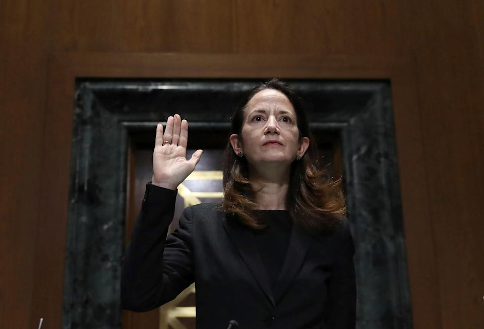 President-elect Joe Biden's pick for national intelligence director Avril Haines is sworn in during a confirmation hearing before the Senate intelligence committee on Tuesday, Jan. 19, 2021, in Washington.