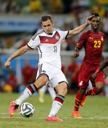 Germany's Miroslav Klose takes a shot during the group G World Cup soccer match between Germany and Ghana at the Arena Castelao in Fortaleza, Brazil, Saturday, June 21, 2014. (AP Photo/Frank Augstein)