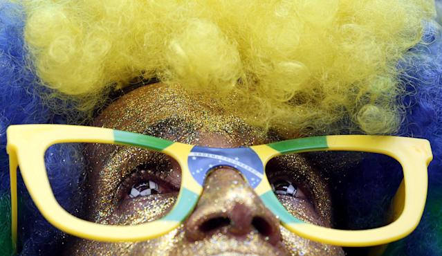 REFILE - CORRECTING LOCATION A fan watches the broadcast of the World Cup Group E soccer match between Brazil and Costa Rica downtown of Sao Paulo, Brazil June 22, 2018. REUTERS/Paulo Whitaker
