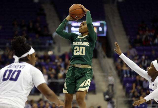 Baylor guard Juicy Landrum (20) shoots over TCU during the second half of an NCAA college basketball game Saturday, Jan. 12, 2019, in Fort Worth, Texas. (AP Photo/Ron Jenkins)