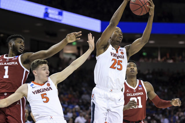 Virginia's Mamadi Diakite (25) and Kyle Guy (5) compete for a rebound against Oklahoma's Rashard Odomes (1) and Kristian Doolittle (21) during the first half of a second-round game in the NCAA men's college basketball tournament Sunday, March 24, 2019, in Columbia, S.C. (AP Photo/Sean Rayford)