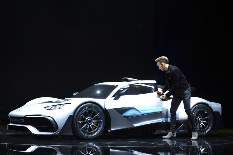 Formula One driver Lewis Hamilton arrives in a Mercedes-AMG Project One car during a press presentation at the Mercedes-Benz stand on the first media day of the Frankfurt Motor Show IAA in Frankfurt, Germany, Tuesday, Sept. 12, 2017. From frighteningly fast hypercars to new electric SUVs, the Frankfurt auto show is a major event for car lovers wanting to get a glimpse of the future. (Uwe Anspach/dpa via AP)