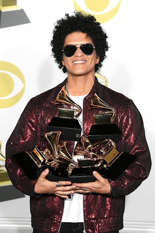 <p>While a win for Album of the Year was expected, it was a surprise that Mars also swept Record and Song of the Year. He's the first male artist to win all three awards in one year since Eric Clapton, 25 years ago. (Photo: Steve Granitz/WireImage) </p>