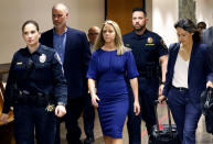 Former Dallas police officer Amber Guyger, center, arrives for the first day of her murder trial in the 204th District Court at the Frank Crowley Courts Building in Dallas, Monday, Sept. 23, 2019. Guyger is accused of shooting her black neighbor in his Dallas apartment. (Tom Fox/The Dallas Morning News via AP, Pool)