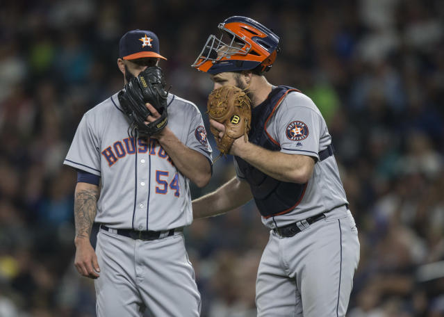 Evan Gattis (right) and Mike Fiers during happier times in 2016. (Photo by Stephen Brashear/Getty Images)