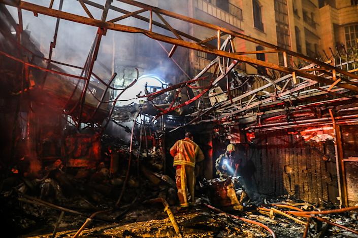 First responders search for survivors at the scene of an explosion at the Sina At'har health centre in the north of Iran's capital Tehran northern Tehran on June 30, 2020.(Amir Kholousi/ISNA/AFP via Getty Images)