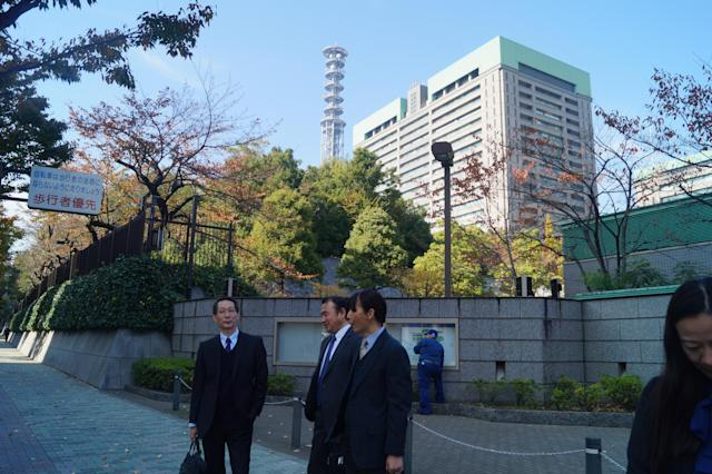 <p>Businessmen outside the Ministry of Defense Headquarters in Ichigaya, Shinjuku, Tokyo. (Photo: Michael Walsh/Yahoo News) </p>