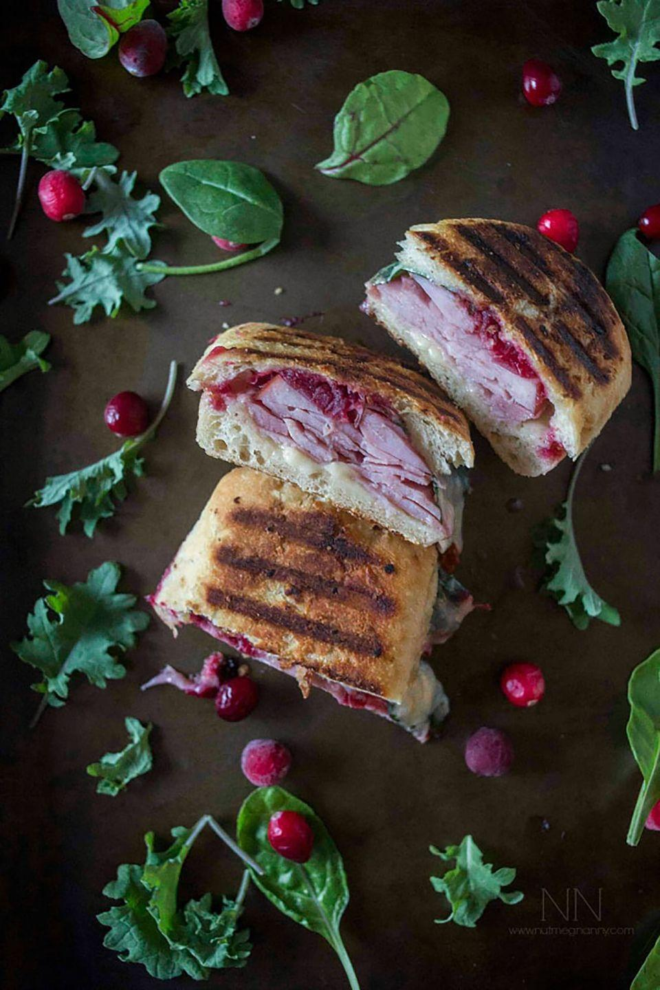 """<p>Christmas ham takes on a new life when paired with cranberries in this toasted, cheesy sandwich.</p><p><strong>Get the recipe at <a href=""""https://www.nutmegnanny.com/ham-cheddar-cranberry-melt/"""" rel=""""nofollow noopener"""" target=""""_blank"""" data-ylk=""""slk:Nutmeg Nanny"""" class=""""link rapid-noclick-resp"""">Nutmeg Nanny</a>.</strong><br></p>"""