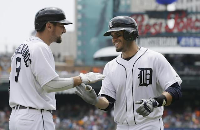 Detroit Tigers' J.D. Martinez, right, is congratulated after his solo home run by teammate Nick Castellanos during the fourth inning of a baseball game against the Kansas City Royals in Detroit, Thursday, June 19, 2014. (AP Photo/Carlos Osorio)