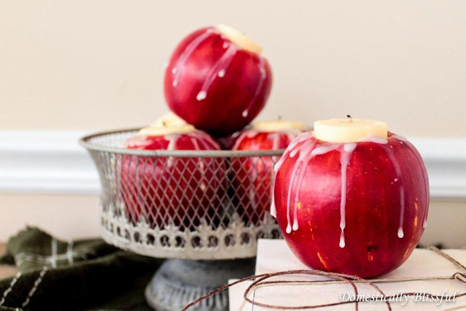 "<p>Add an understated pop of color to your Thanksgiving table with these apple candleholders. Because this craft requires real apples, you'll also fill your house with a crisp fall aroma.</p><p><em><a href=""http://domesticallyblissful.com/diy-apple-candle-holders/"" rel=""nofollow noopener"" target=""_blank"" data-ylk=""slk:Get the tutorial at Domestically Blissful »"" class=""link rapid-noclick-resp"">Get the tutorial at Domestically Blissful »</a></em></p>"