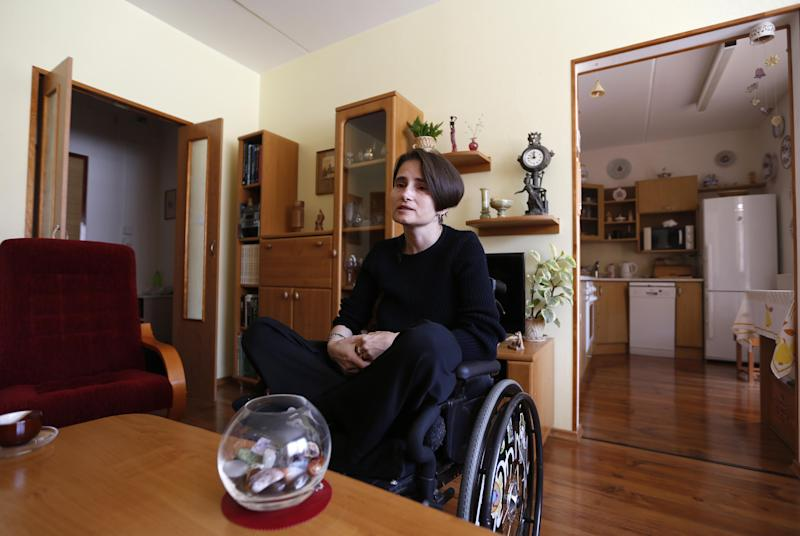 To go with Czech Medical Marijuana by Karel Janicek Martina Kafkova, patient diagnosed with multiple sclerosis, answers questions during an interview with The Associated Press at her home in Tyn nad Vltavou, Czech Republic, Monday, Oct. 14, 2013. Confined to a wheelchair, the former non-smoker needs five short joints a day to get relief from severe stiffness, painful spasms and breathing troubles because other available medicine is not effective enough to help. Czech Republic has approved legislation for use of medical marijuana but it is still impossible to obtain it in legal way. (AP Photo/Petr David Josek)