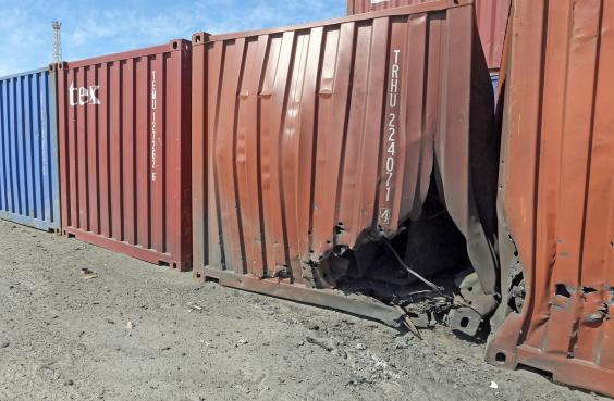 A damaged container is pictured at a port in Libya's capital Tripoli after it was hit by rocket fire (AFP via Getty Images)