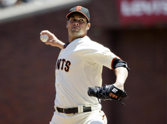 San Francisco Giants starting pitcher Ryan Vogelsong throws to the Miami Marlins during the first inning of a baseball game on Sunday, May 18, 2014, in San Francisco. (AP Photo/Marcio Jose Sanchez)