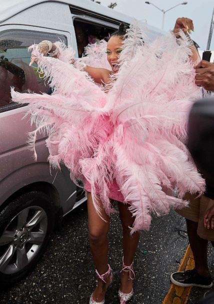 PHOTO: Superstar Rihanna arrives for the start of Barbados' Crop Over Festival in a pink feathered costume, August 5, 2019. (SplashNews.com)
