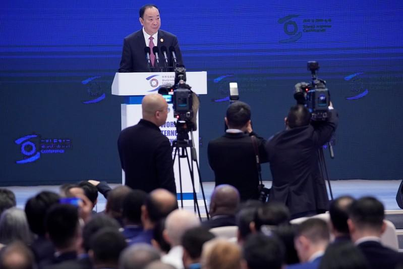 Huang Kunming, head of the Propaganda Department of China's Communist Party Central Committee, reads a message from Chinese President Xi Jinping at the opening ceremony of the fifth World Internet Conference (WIC) in Wuzhen