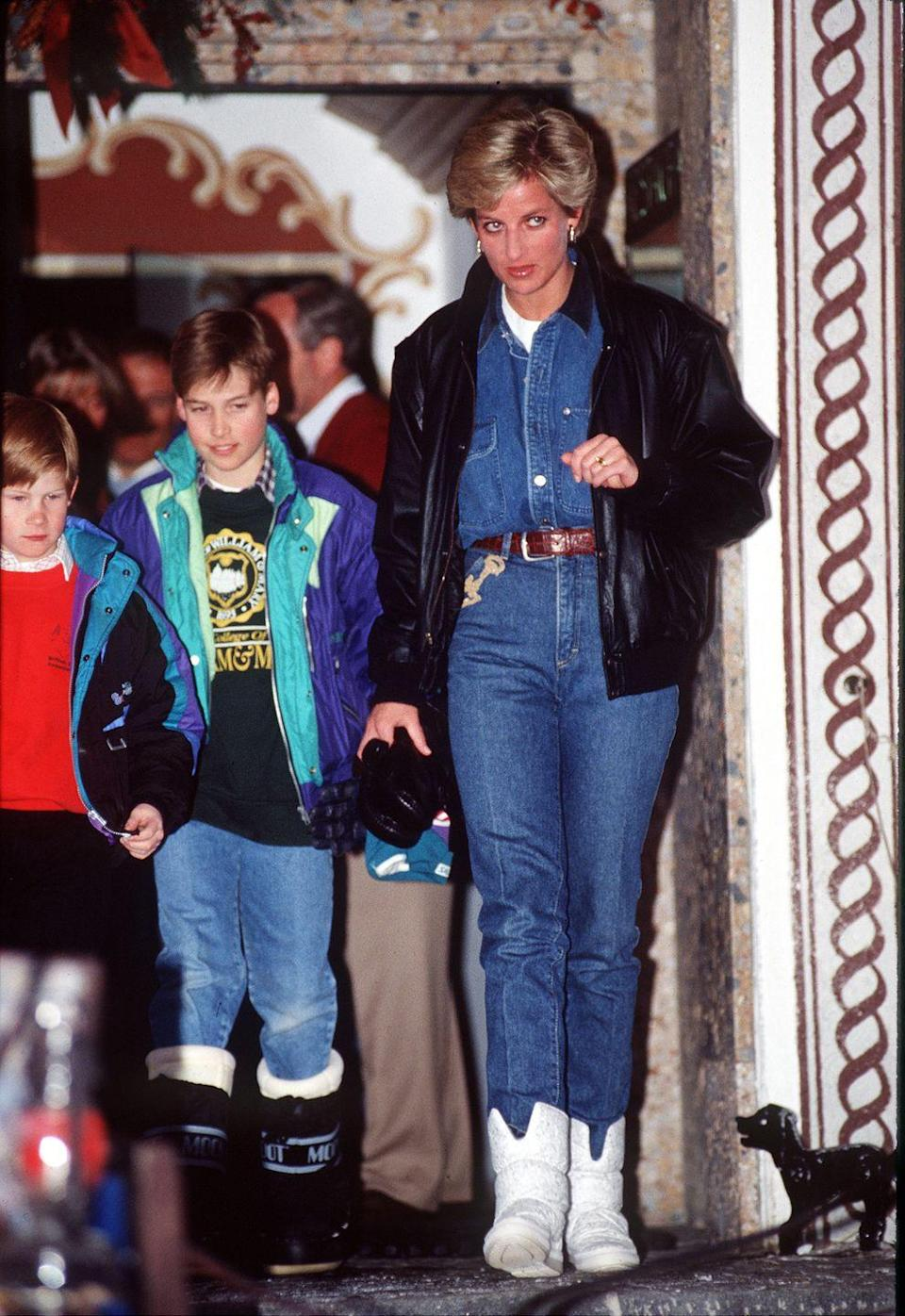 <p>Is this 90s apres-ski style at its best? Princess Diana wore double-denim on holiday in Lech, Austria with her sons in 1993. Peep William's Moon Boots, too! Meanwhile, we'll be scouring charity shops for a leather bomber jacket like Diana's.</p>