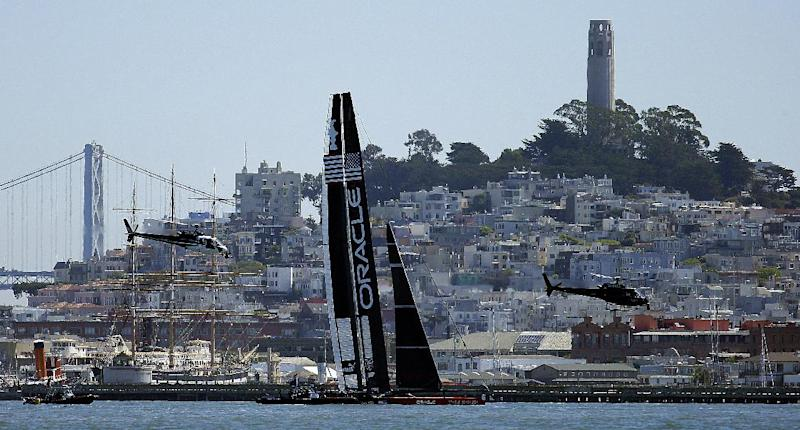 Oracle Team USA practices near the San Francisco waterfront and Coit Tower prior to the 16th race of the America's Cup sailing event against Emirates Team New Zealand Monday, Sept. 23, 2013, in San Francisco. (AP Photo/Ben Margot)