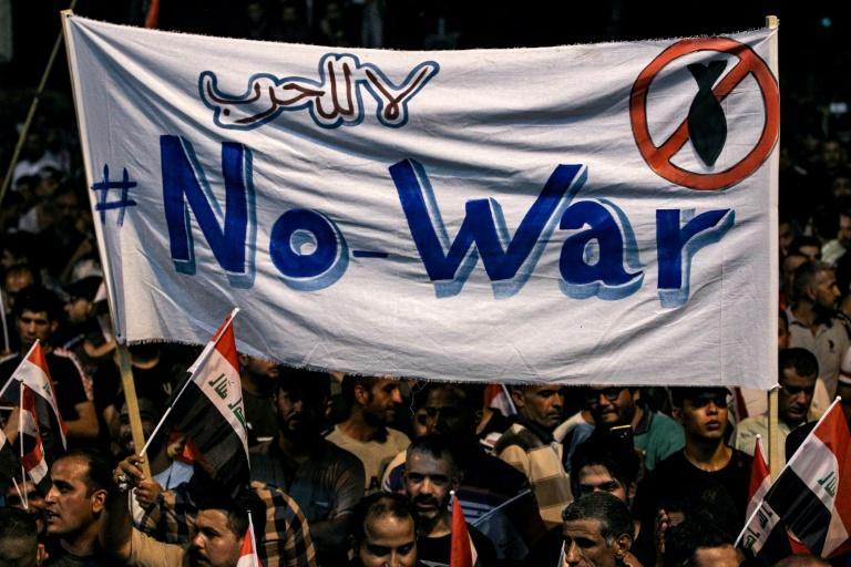 Iraqi protesters called for their country to be spared involvement in a confrontation between the US and Iran