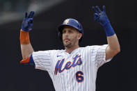 New York Mets' Jeff McNeil reacts after hitting a two-RBI double in the sixth inning against the Toronto Blue Jays during a baseball game Sunday, July 25, 2021, in New York. (AP Photo/Adam Hunger)