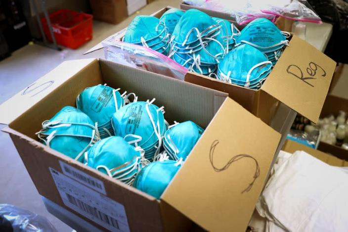 FILE PHOTO: Boxes of N95 protective masks for use by medical field personnel are seen at a New York State emergency operations incident command center during the coronavirus outbreak in New Rochelle