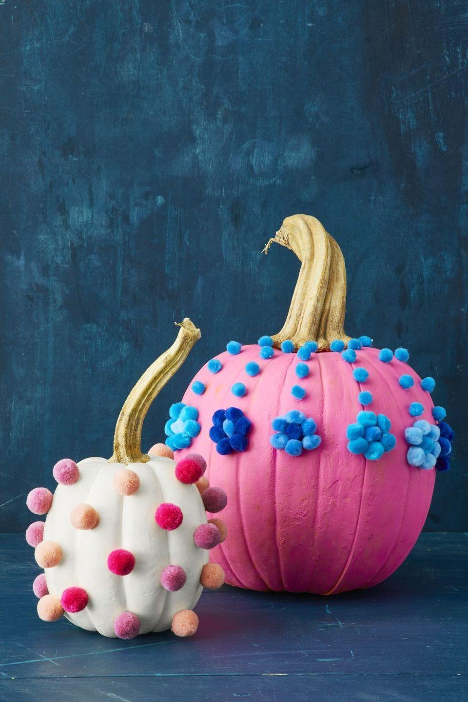 """<p>Dress painted pumpkins up in colorful pom poms for a playful look that's perfect for a festive celebration with children in attendance. </p><p><a class=""""link rapid-noclick-resp"""" href=""""https://go.redirectingat.com?id=74968X1596630&url=https%3A%2F%2Fwww.michaels.com%2Fcreatology-pom-poms-christmas-mix%2F10580712.html&sref=https%3A%2F%2Fwww.goodhousekeeping.com%2Fholidays%2Fhalloween-ideas%2Fg33437890%2Fhalloween-table-decorations-centerpieces%2F"""" rel=""""nofollow noopener"""" target=""""_blank"""" data-ylk=""""slk:SHOP POM POMS"""">SHOP POM POMS</a></p>"""
