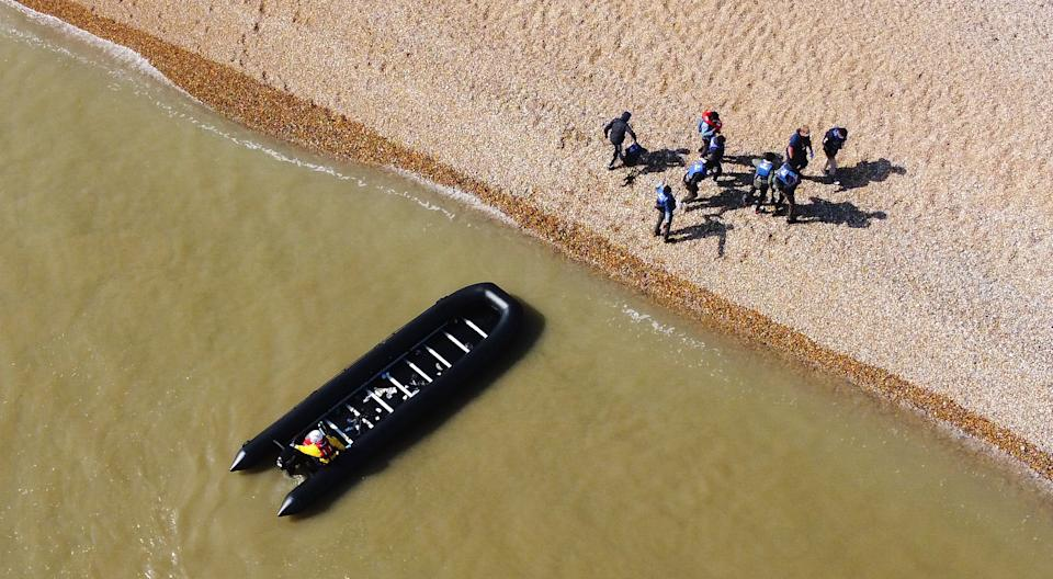 A group of people thought to be migrants are escorted to shore in Kingsdown, Kent, after being intercepted by an RNLI crew following a small boat incident in the Channel. Picture date: Tuesday September 7, 2021.