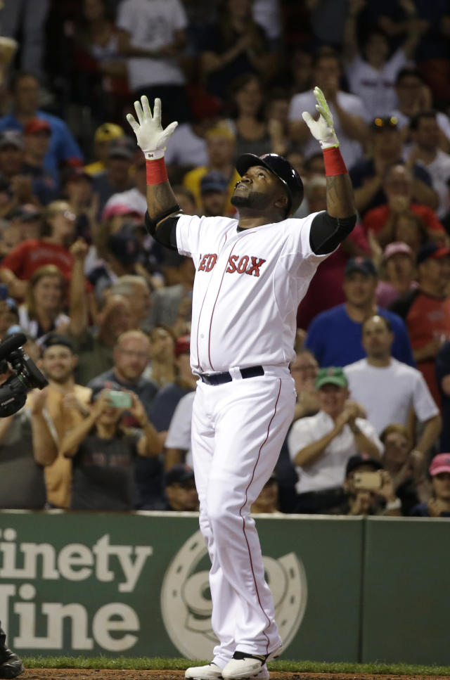 Boston Red Sox's David Ortiz celebrates his three-run home run as he arrives at home plate in the fifth inning of a baseball game against the Detroit Tigers, Sunday, July 26, 2015, in Boston. (AP Photo/Steven Senne)