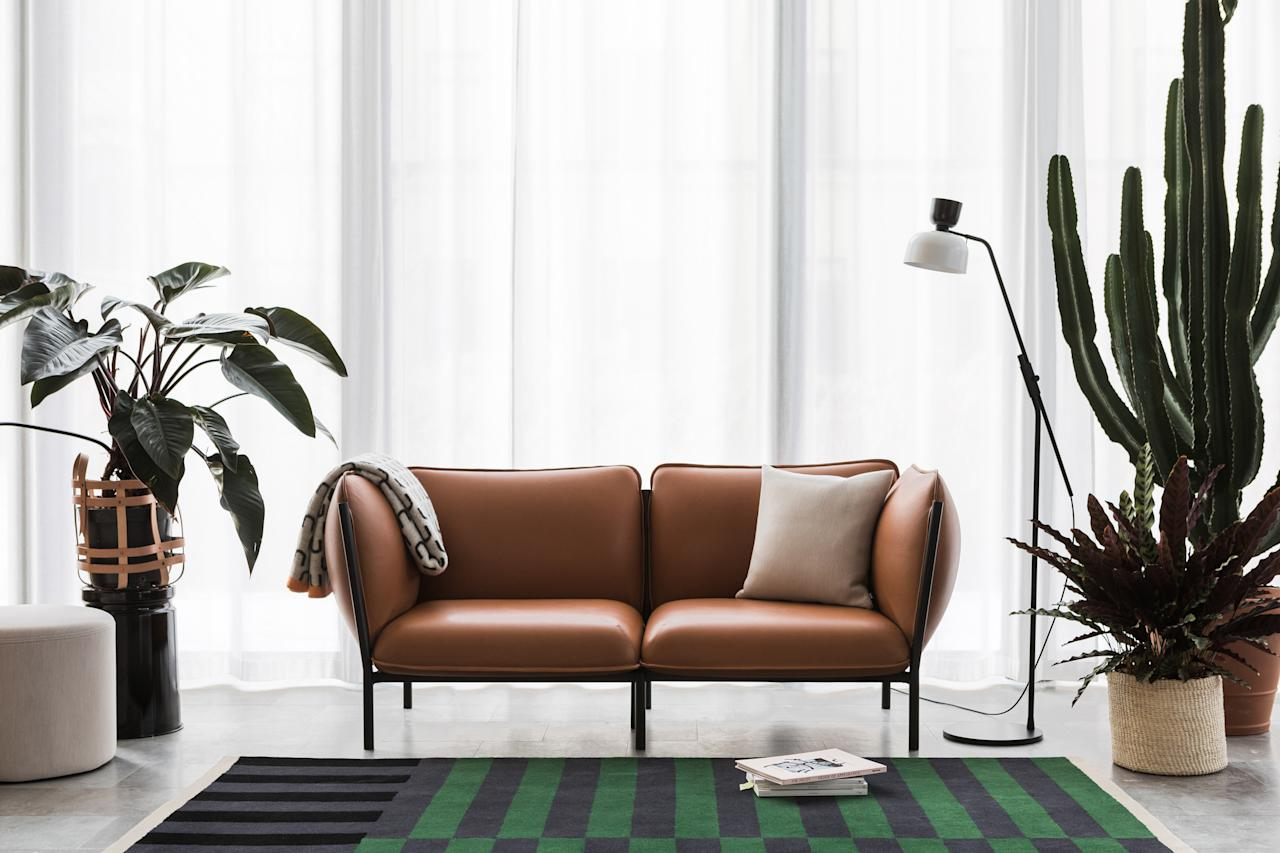 """Swedish sensation <a rel=""""nofollow"""" href=""""https://www.architecturaldigest.com/story/hem-sweden-petrus-palmer?mbid=synd_yahoo_rss"""">Hem</a> planted its flag—or rather, hung it from a window—in Brera, where it debuted an array of new offerings, all ingeniously constructed for easy assembly and delivery. Among other news, a modular seating system designed by Anderssen & Voll can be expanded from a single lounge chair to a sprawling sofa, and Luca Nichetto has translated his crowd-pleasing lighting system (with interchangeable shades in many colors and shapes) into a floor lamp.<em>—Sam Cochran</em>"""