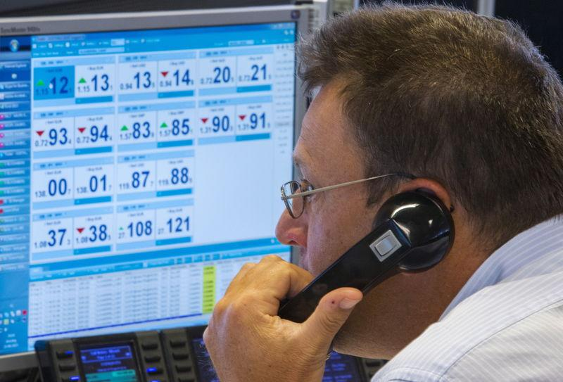Trader looks at screens on the KBC bank trading floor in Brussels