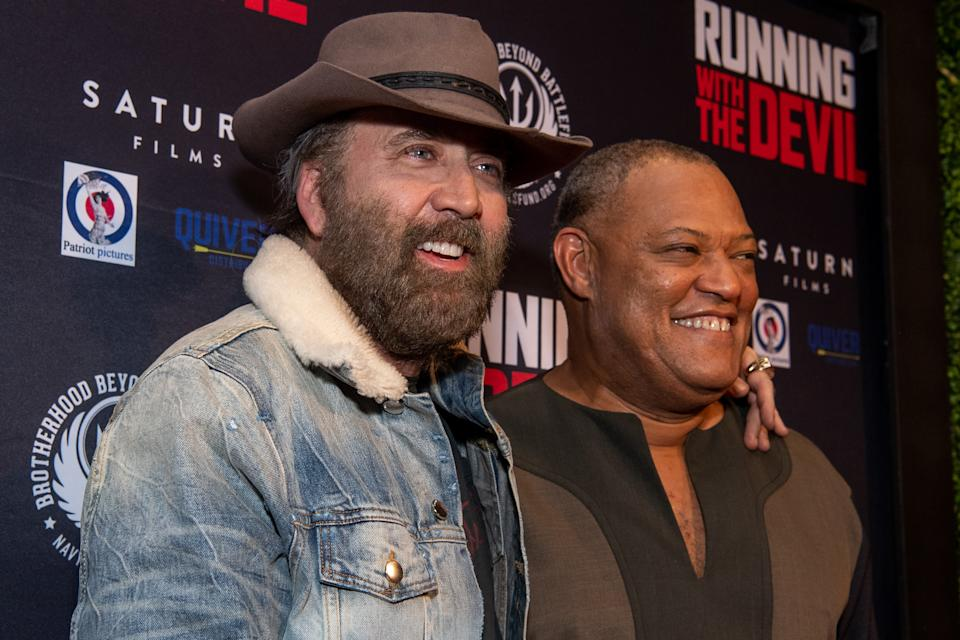 BEVERLY HILLS, CALIFORNIA - SEPTEMBER 16: Laurence Fishburne and Nicolas Cage attend the premiere of Quiver Distribution's 'Running with the Devil' at Writers Guild Theater on September 16, 2019 in Beverly Hills, California. (Photo by Emma McIntyre/Getty Images)