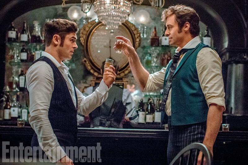 Here's to a hit musical: Zac Efron and Hugh Jackman in 'The Greatest Showman' (credit: 20th Century Fox/EW)