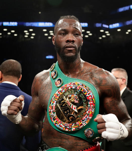 FILE - In this March 3, 2018, file photo, Deontay Wilder poses for photographs after the WBC heavyweight champion defeated Luis Ortiz in New York. Wilder is slated to defend his title May 18, 2019, at Barclays Center in New York, against mandatory challenger Dominic Breazeale. (AP Photo/Frank Franklin II, File)