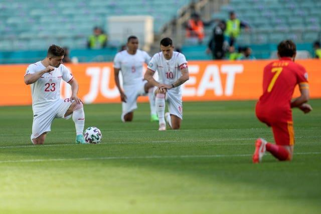 Switzerland and Wales players took the knee on Saturday