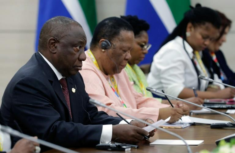 """South African President Cyril Ramaphosa, among the first to meet with Putin at the summit, praised Russia's """"whole effort of strengthening its relationship with the African continent"""" (AFP Photo/Mikhail METZEL)"""