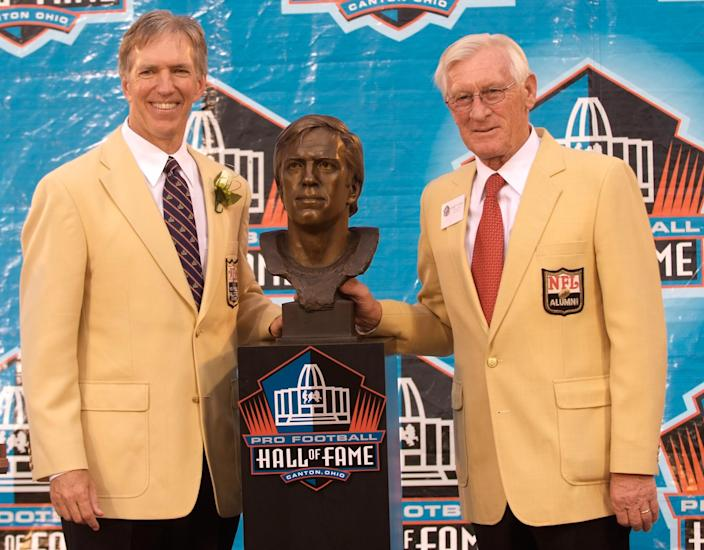 Roger Wehrli in his Hall of Fame jacket and Larry Wilson next to him in his jacket.