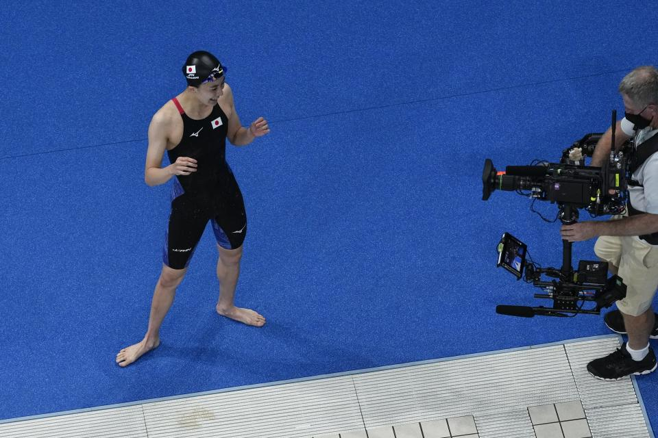 Yui Ohashi, of Japan, reacts after winning the women's 200-meter individual medley final at the 2020 Summer Olympics, Wednesday, July 28, 2021, in Tokyo, Japan. (AP Photo/Morry Gash)