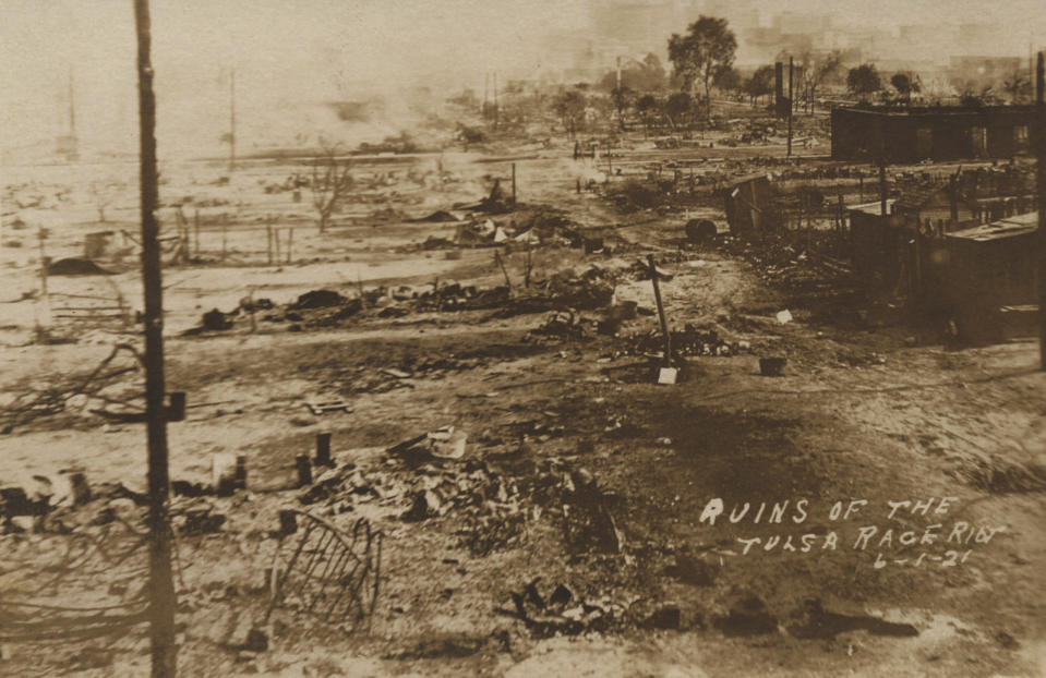 This photo provided by the Department of Special Collections, McFarlin Library, The University of Tulsa shows the ruins of Dunbar Elementary School and the Masonic Hall in the aftermath of the June 1, 1921, Tulsa Race Massacre in Tulsa, Okla. (Department of Special Collections, McFarlin Library, The University of Tulsa via AP)