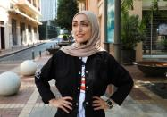 Israa Seblani, a Lebanese doctor and the bride who was caught up in the last year's Beirut port blast during a wedding photoshoot, poses for a picture at the same place where she was standing in the moment of August 4 explosion, in Beirut