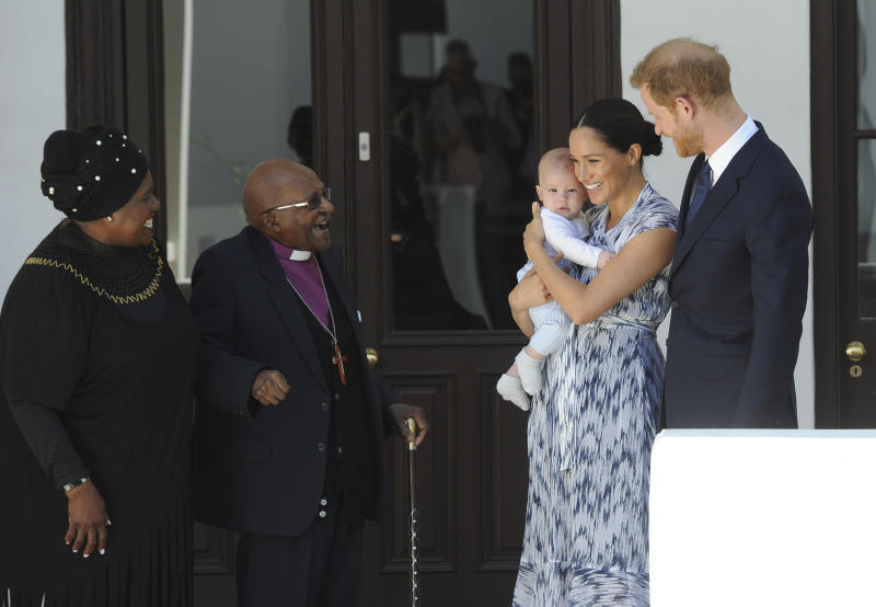 Britain's Prince Harry and Meghan, Duchess of Sussex, holding their son Archie, meet Anglican Archbishop Emeritus, Desmond Tutu and his wife Leah in Cape Town, South Africa,Wednesday, Sept. 25, 2019. The royal couple are on the third day of their African tour. (Henk Kruger/African News Agency via AP, Pool)