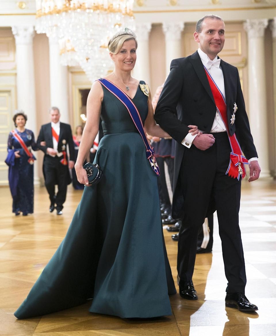<p>Oozing glamour in green on Wednesday [Photo: Rex] </p>