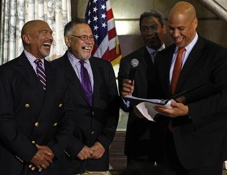 U.S. Senator-elect Cory Booker (D-NJ) and current Mayor of Newark marries Orville Bell (L) and Joseph Panessidi in Newark, New Jersey October 21, 2013.