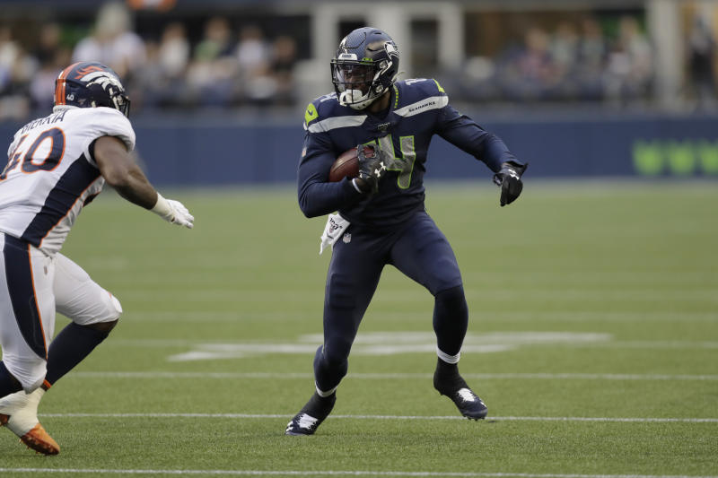 Seattle Seahawks wide receiver DK Metcalf runs the ball after a reception against the Denver Broncos during the first half of an NFL football preseason game Thursday, Aug. 8, 2019, in Seattle. (AP Photo/Stephen Brashear)