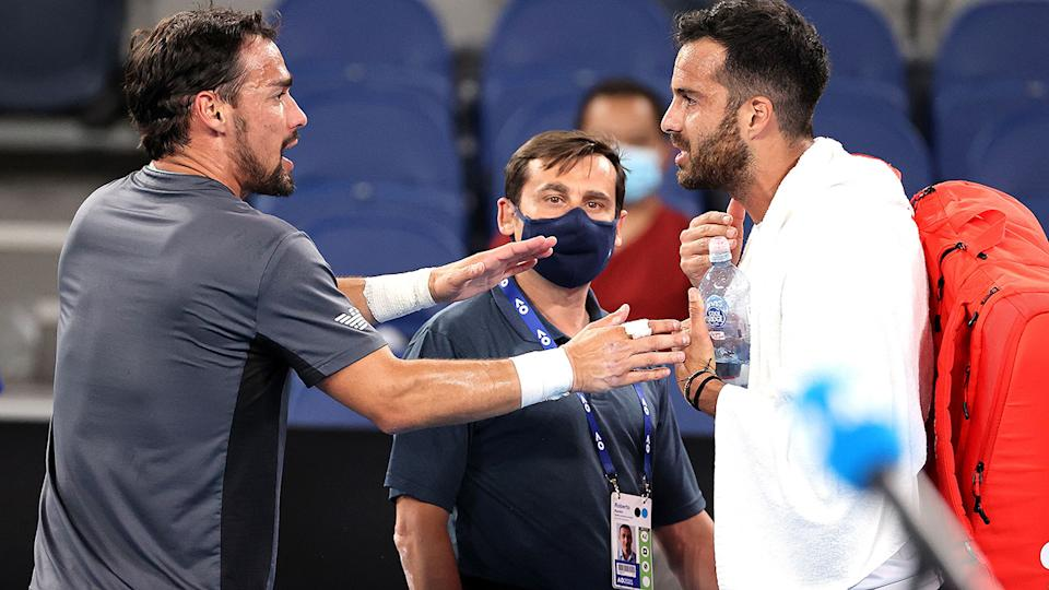 Fabio Fognini and Salvatore Caruso, pictured here arguing after their match at the Australian Open.