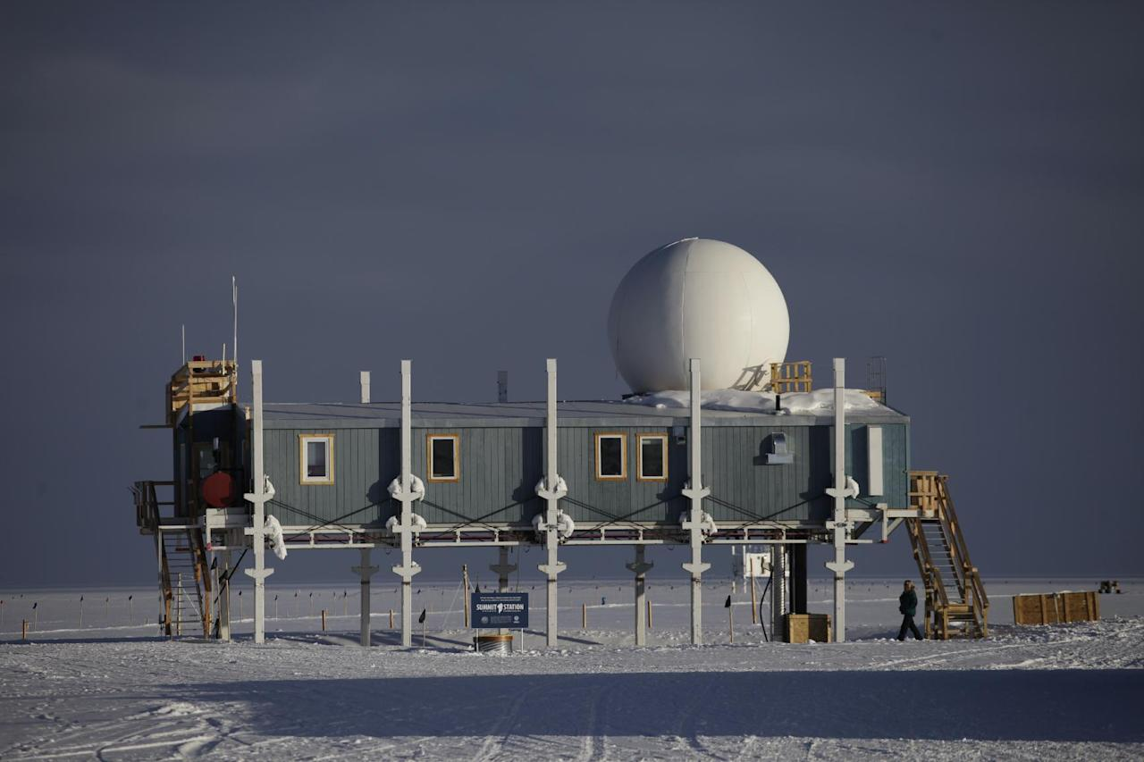 This July 15, 2011 photo shows the main building at Summit Station, a remote research site operated by the U.S. National Science Foundation, (NSF), situated 10,500 feet above sea level, on top of the Greenland ice sheet. The structure is periodically jacked up on its support columns to stay above accumulating snow. Across Greenland's vast white landscape, teams of researchers from around the world are searching for clues to the potential effects of global warming on Greenland's ice. (AP Photo/Brennan Linsley)