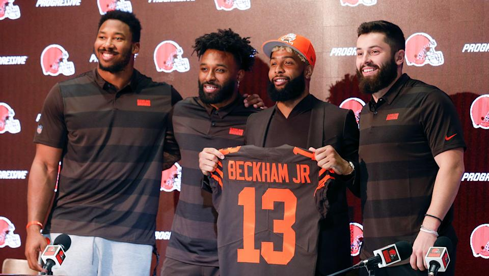 Cleveland Browns' Odell Beckham poses with his jersey along with Baker Mayfield, right, Myles Garrett, left, and Jarvis Landry during a news conference Monday, April 1, 2019, in Berea, Ohio. (AP Photo/Ron Schwane)