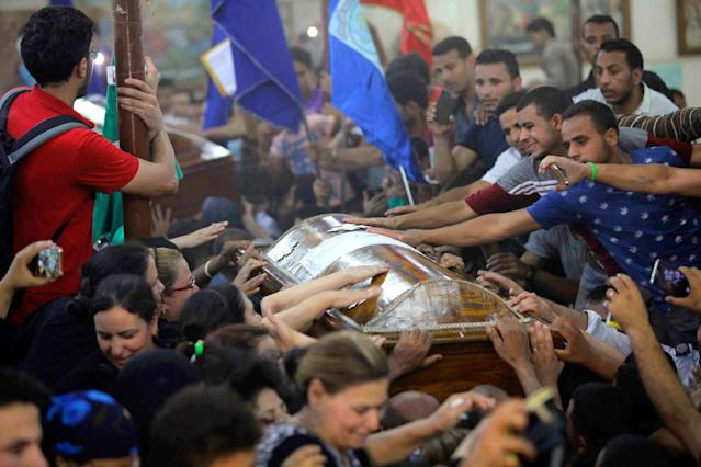 <p>Friends and family members of the victims of the terrorist attack by armed men on a bus carrying coptic Christians can be seen mournning in Al-Minya, Egypt. At leat 28 were killed. (Photo: DPA via ZUMA Press) </p>