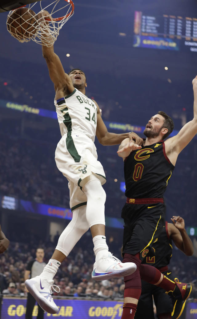 Milwaukee Bucks' Giannis Antetokounmpo (34) dunks against Cleveland Cavaliers' Kevin Love (0) in the first half of an NBA basketball game, Friday, Nov. 29, 2019, in Cleveland. (AP Photo/Tony Dejak)